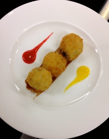 Rice Pudding Arancini with Chocolate Truffle, Raspberry and Mango Coulis